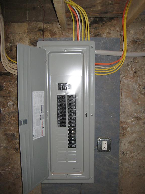 to panel in an unfinished basement installed by lauterborn electric